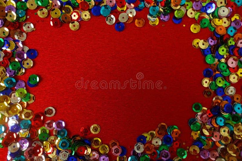 Czerwony tło z ramą od kolorowych dekoracji zdjęcia royalty free