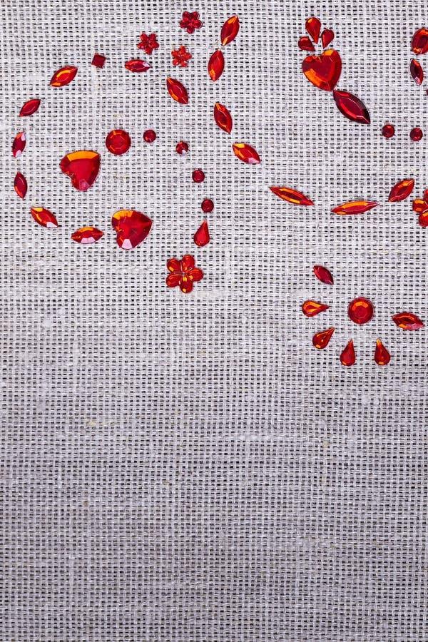 Czerwonych cekinów kwiecisty ornament fotografia stock