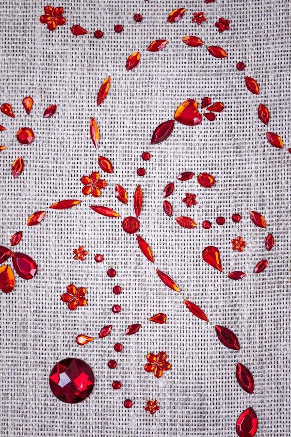 Czerwonych cekinów kwiecisty ornament fotografia royalty free