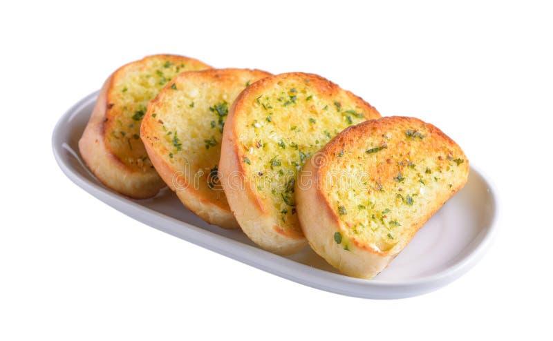 Czosnku chleb w bielu talerzu zdjęcia royalty free