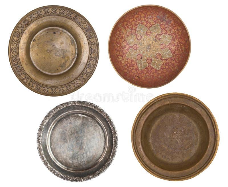 Cztery antyka metal malującego talerza odizolowywającego na białym tle styl retro Rocznik zdjęcia stock
