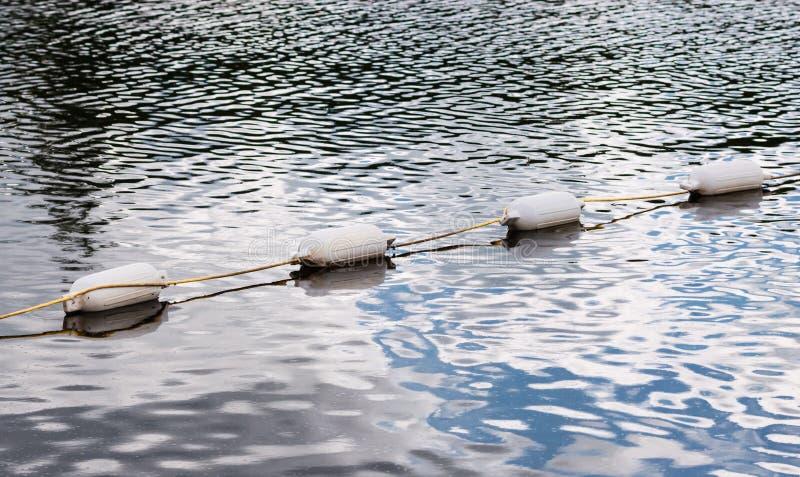Cztery biały spławowy markier pociesza na wodzie zdjęcie royalty free