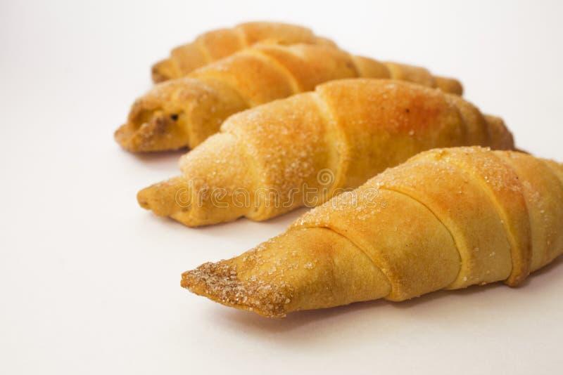 Cztery croissants na białym tle obrazy stock