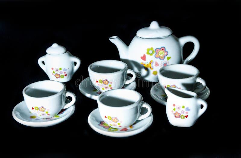 Cztery filiżanki i trzy zbiornika dla wszystkie rodzajów napoje fotografia royalty free
