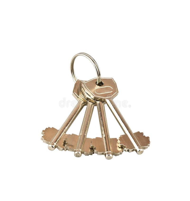 Cztery klucza na białym tle zdjęcia stock