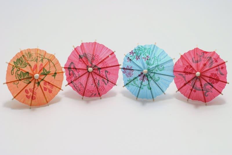cztery koktajlowe parasolki obrazy stock