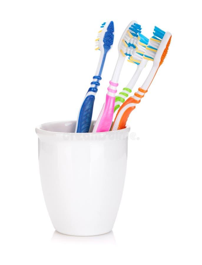 Cztery kolorowego toothbrushes fotografia royalty free