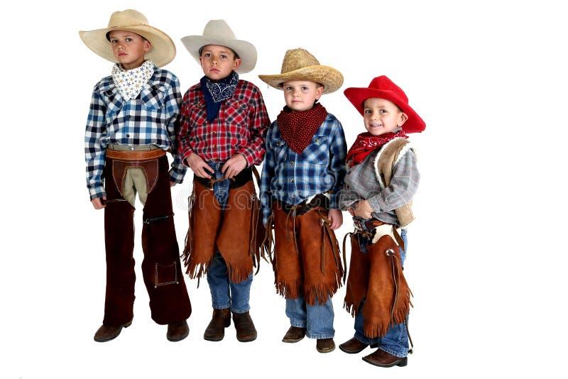 Cztery kowbojskiego brata stoi będący ubranym kapelusze i kumpel obrazy stock
