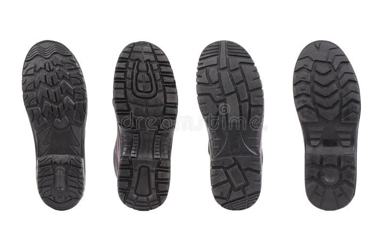 Cztery obuwianej podeszwy w rzędzie. zdjęcia royalty free