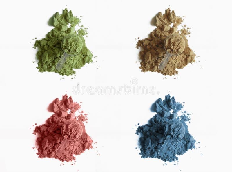 Cztery różnorodnego rozsypiska proteina proszek na białym tle obrazy stock
