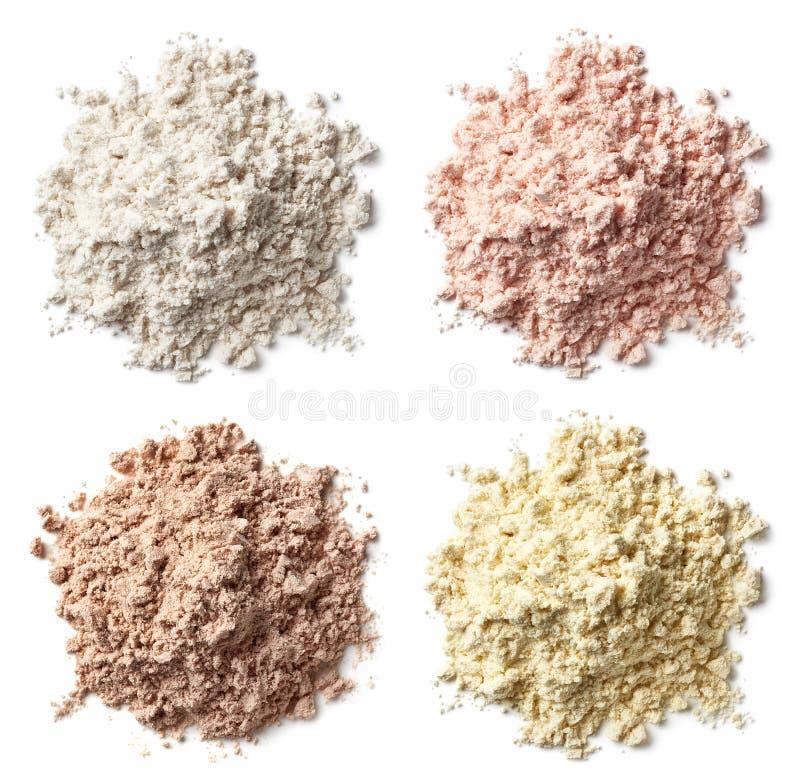 Cztery różnorodnego rozsypiska proteina pudrują wanilii, truskawka, choco obraz stock