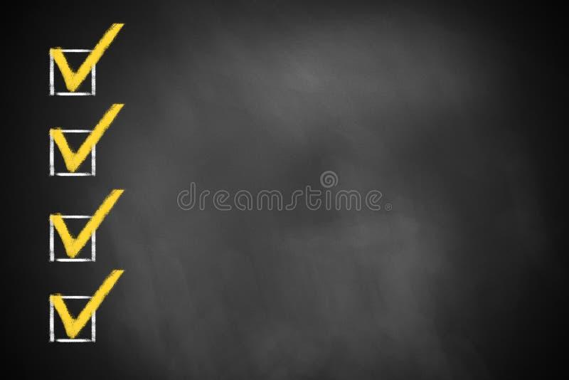 Cztery sprawdzać checkboxes na chalkboard zdjęcie royalty free