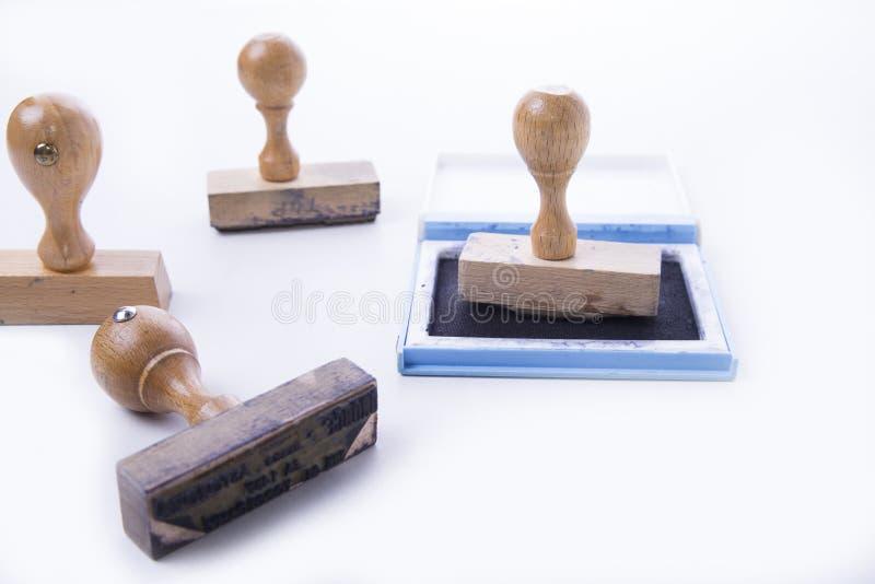 Cztery stara pieczątka z ochraniaczem na białym tle fotografia stock