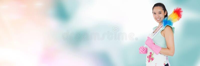 Czysty mienia duster z jaskrawym tłem zdjęcia stock