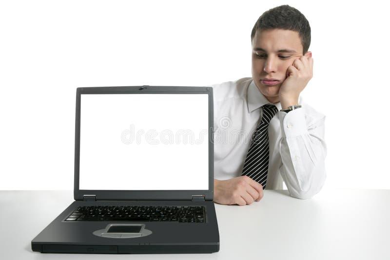 dålig nyheterna för affärsmandatorbärbar dator arkivfoto