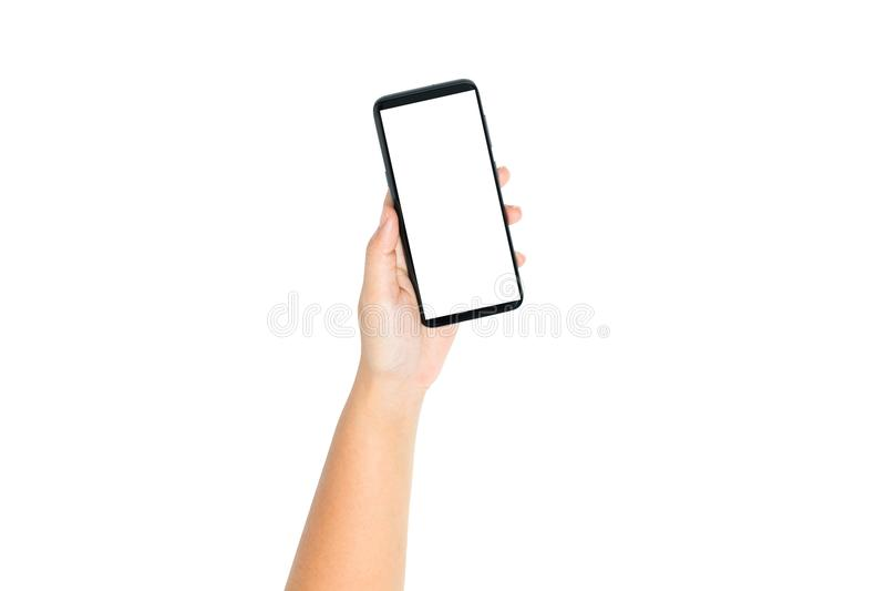 Dé el espacio en blanco del teléfono celular de tenencia en la pantalla blanca y el fondo blanco imágenes de archivo libres de regalías