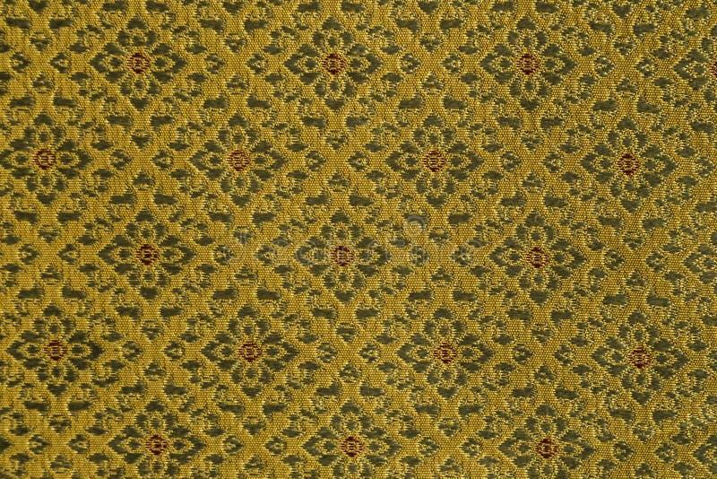Dé la seda tailandesa tradicional tejida, diseño del brocado fotografía de archivo