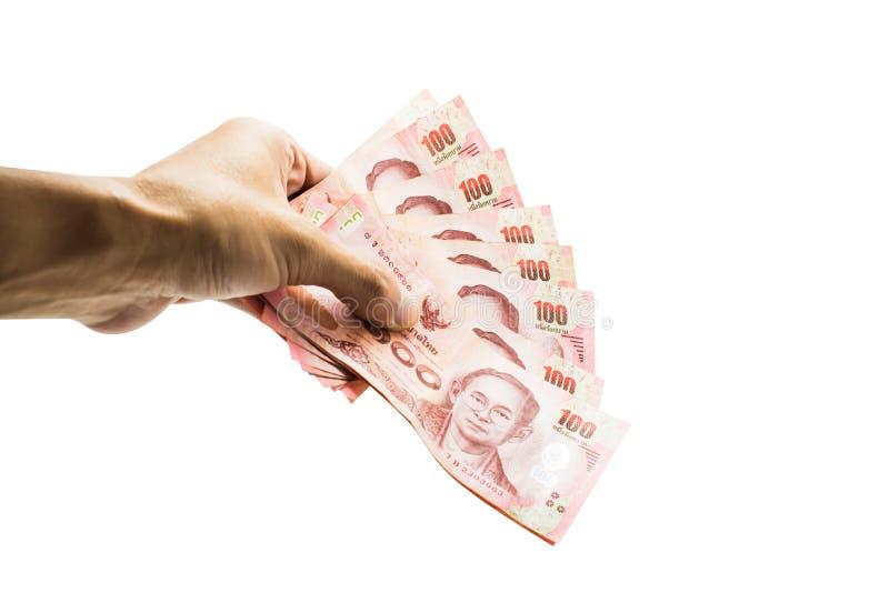 Dé sostener el dinero tailandés aislado en el fondo blanco con clippi fotos de archivo