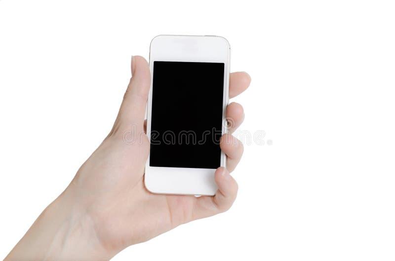 Dé sostener el teléfono elegante móvil con la pantalla en blanco. Aislado en blanco. foto de archivo