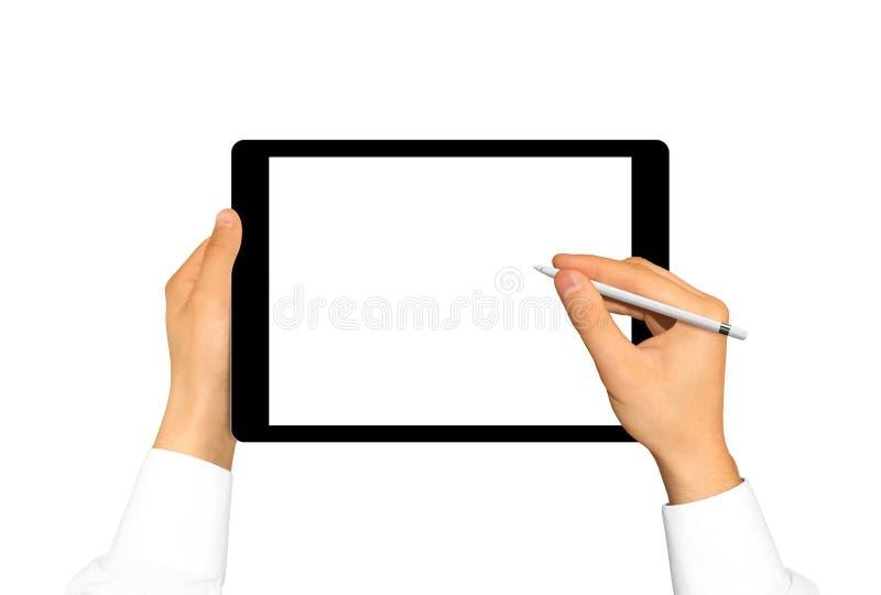 Dé sostener la aguja cerca de la pantalla en blanco de la tableta gráfica Etiqueta vacía imagen de archivo libre de regalías