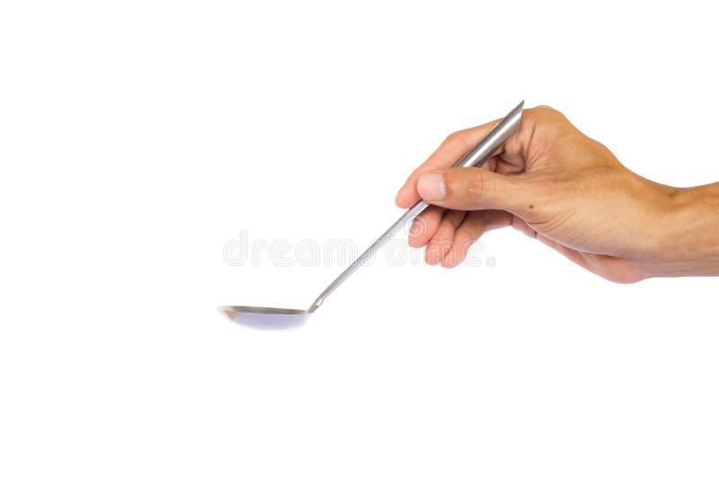 Dé sostener la cucharón para prepararse aislada en el fondo blanco con la trayectoria de recortes foto de archivo