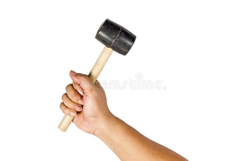 Dé sostener un martillo de goma en un fondo blanco Visión desde el th foto de archivo libre de regalías