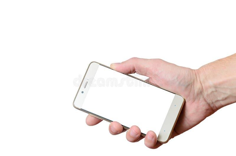 Dé sostener un teléfono aislado en un fondo blanco situado a la derecha abajo fotos de archivo libres de regalías