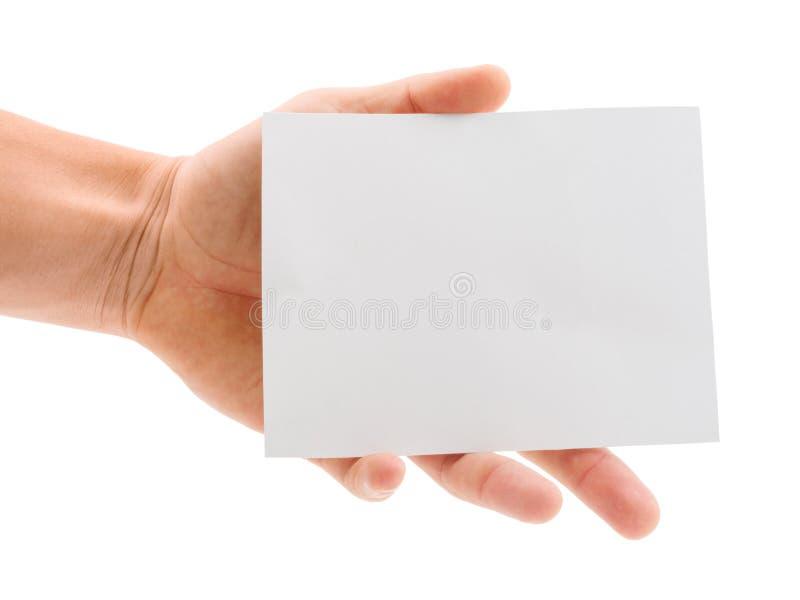 Dé sostener una hoja del papel en blanco aislada en el fondo blanco fotos de archivo libres de regalías