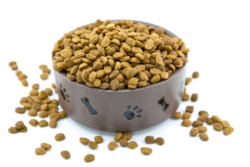 débordement d'aliments pour chiens de cuvette images stock