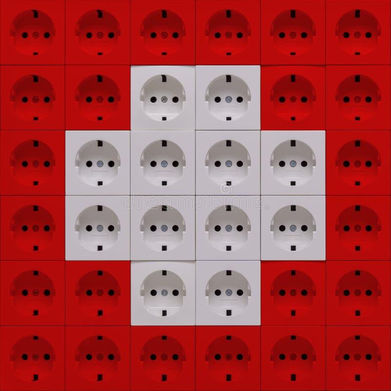 Débouchés électriques dans les couleurs du drapeau de la Suisse image stock