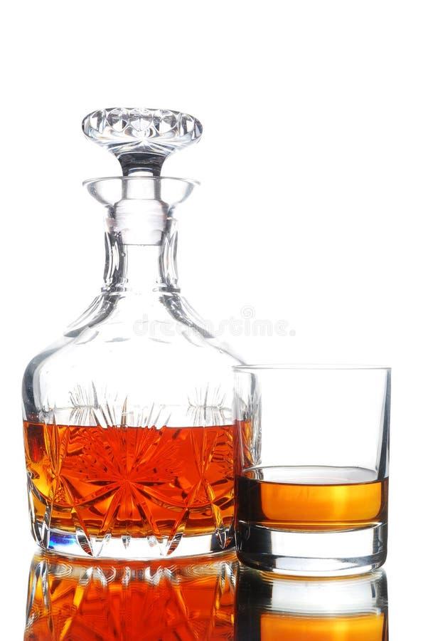 Décanteur et glace de whiskey photographie stock libre de droits