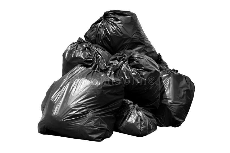 déchets de sac de poubelle, poubelle, déchets, déchets, déchets, pile de sachets en plastique d'isolement sur le blanc de fond images libres de droits