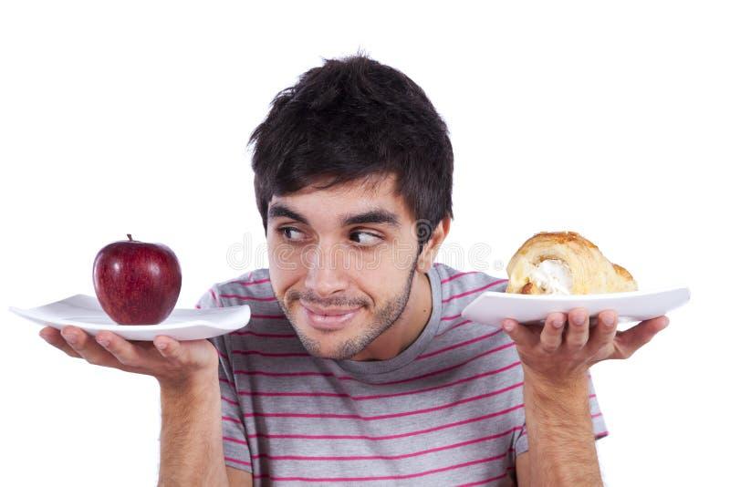 Décision de nourriture de jeune homme image libre de droits