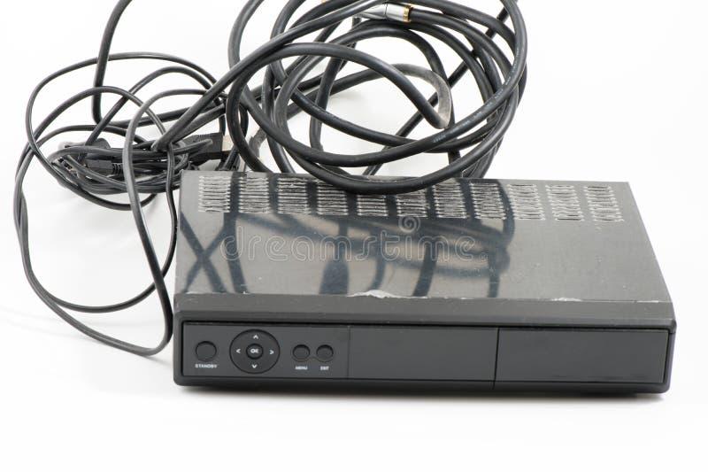 Décodeur et câbles avec le fond blanc photographie stock