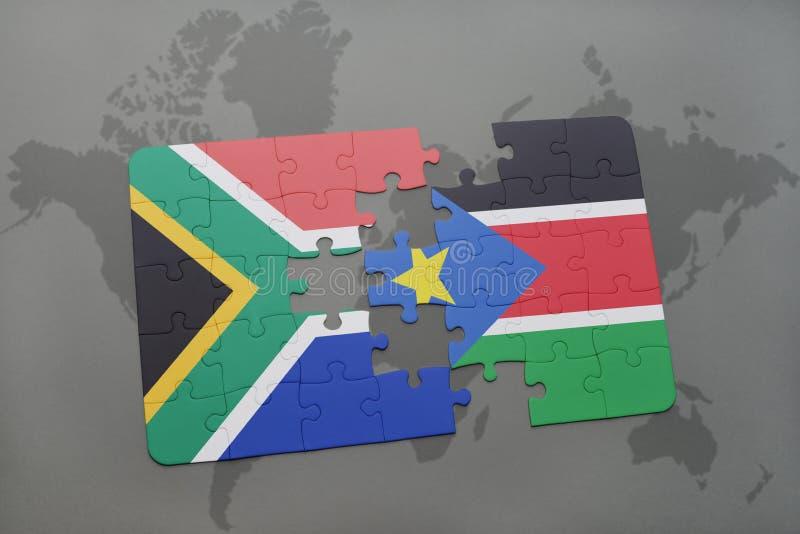 déconcertez avec le drapeau national de l'Afrique du Sud et des sud Soudan sur une carte du monde illustration libre de droits