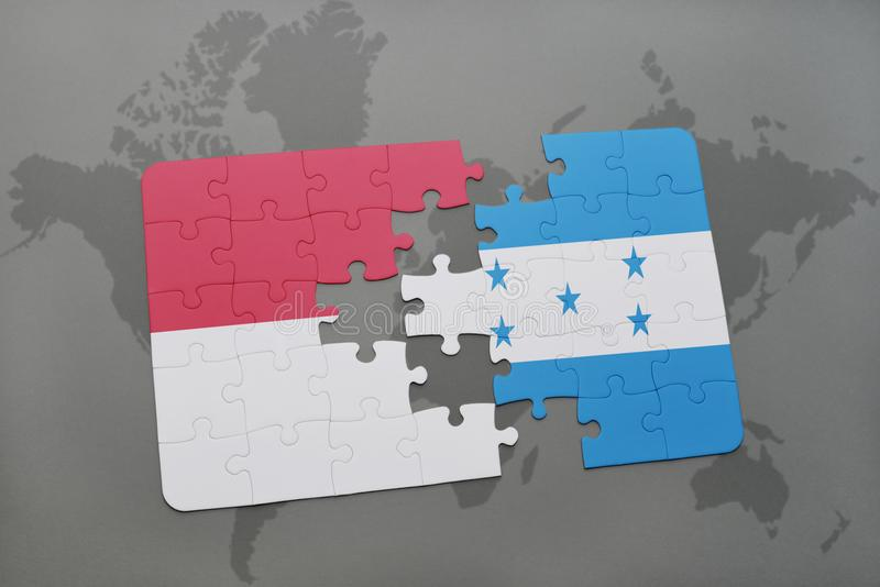 déconcertez avec le drapeau national de l'Indonésie et du Honduras sur un fond de carte du monde illustration de vecteur