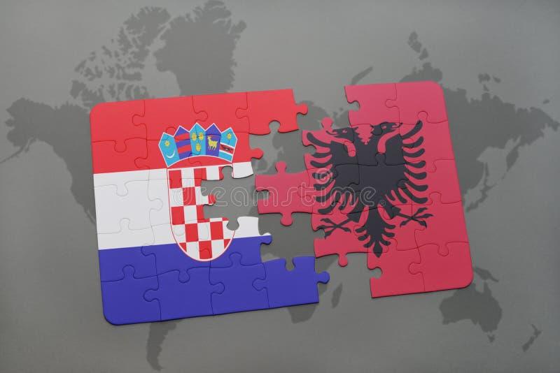 Déconcertez avec le drapeau national de la Croatie et de l'Albanie sur un fond de carte du monde illustration libre de droits