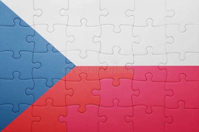 Déconcertez avec le drapeau national de la République Tchèque et de la Pologne images stock