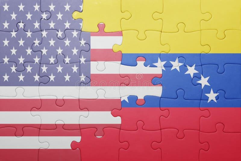 Déconcertez avec le drapeau national des Etats-Unis d'Amérique et du Venezuela image stock