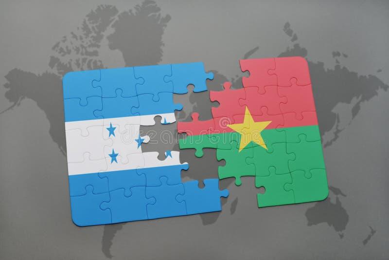 déconcertez avec le drapeau national du Honduras et du Burkina Faso sur une carte du monde illustration stock
