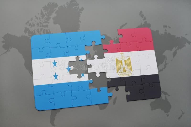 déconcertez avec le drapeau national du Honduras et de l'Egypte sur une carte du monde illustration de vecteur