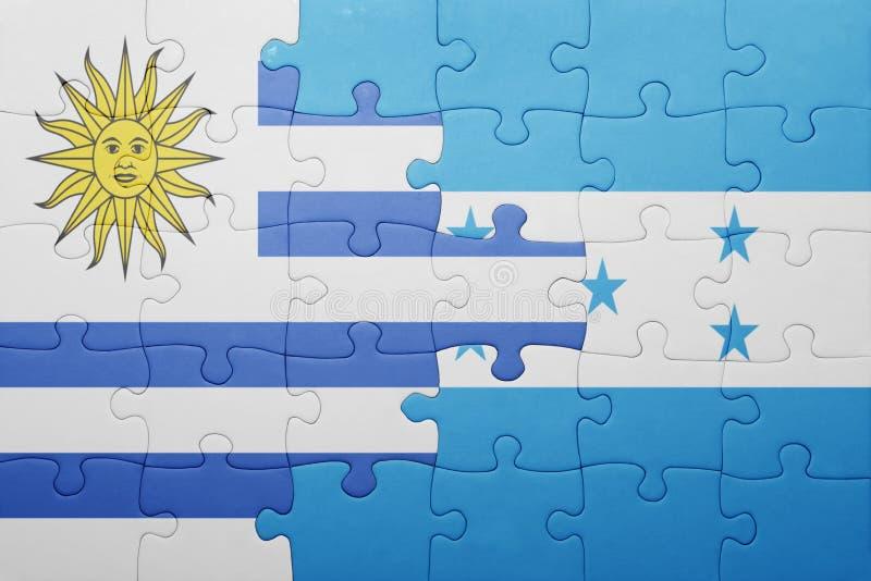 Déconcertez avec le drapeau national du Honduras et de l'Uruguay illustration libre de droits