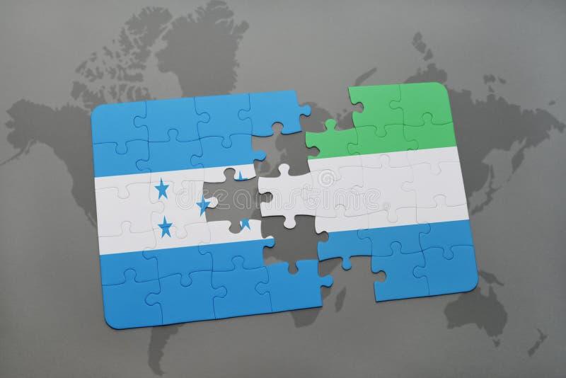 déconcertez avec le drapeau national du Honduras et de la Sierra Leone sur une carte du monde illustration libre de droits