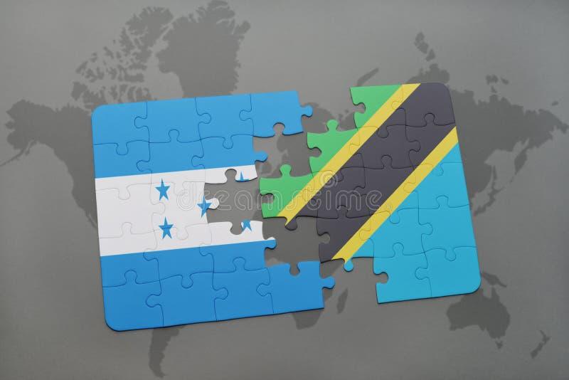 déconcertez avec le drapeau national du Honduras et de la Tanzanie sur une carte du monde illustration stock