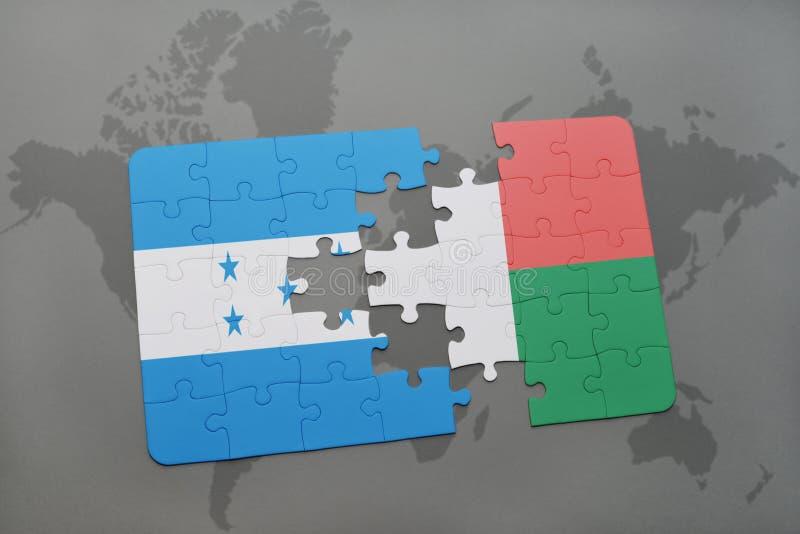 déconcertez avec le drapeau national du Honduras et du Madagascar sur une carte du monde illustration stock