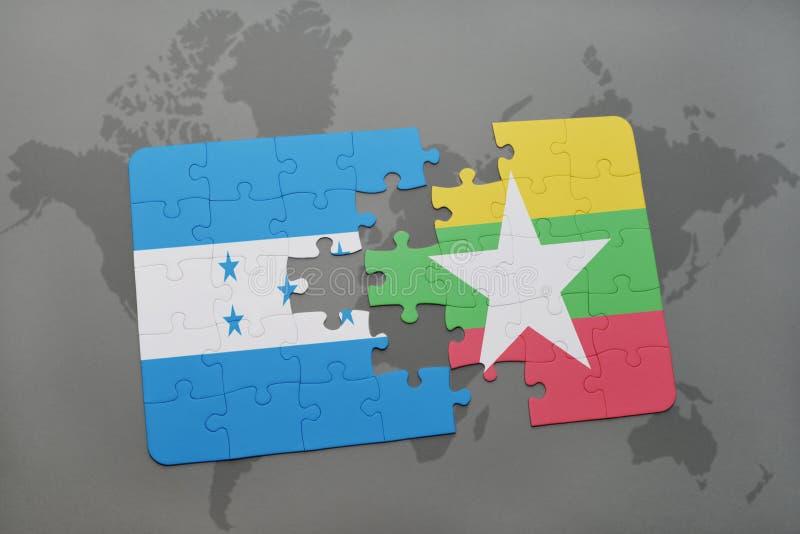 déconcertez avec le drapeau national du Honduras et du myanmar sur une carte du monde illustration stock