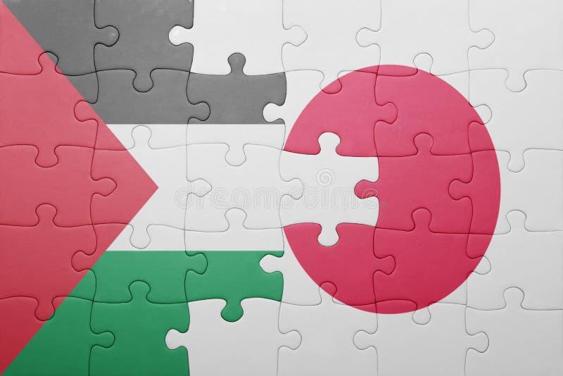 Déconcertez avec le drapeau national du Japon et de la Palestine photo stock