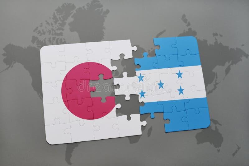 déconcertez avec le drapeau national du Japon et du Honduras sur un fond de carte du monde illustration libre de droits