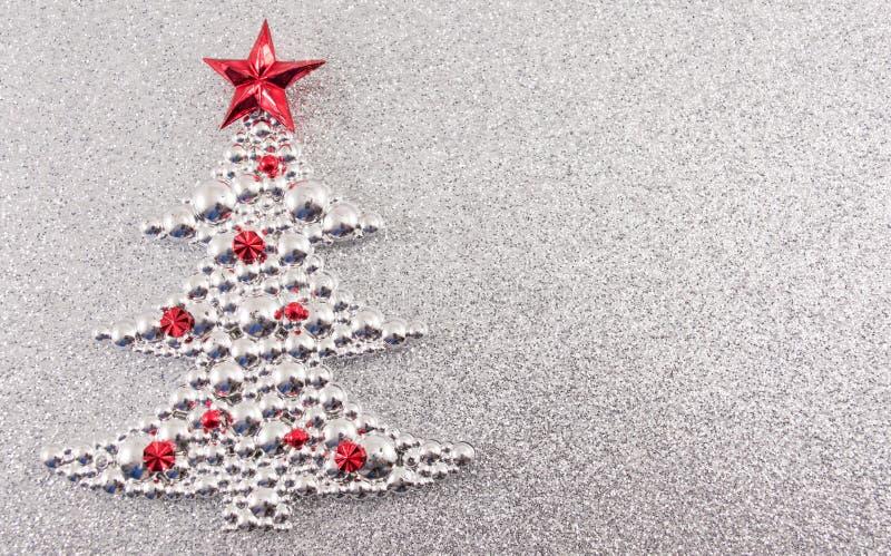 Décoration d'arbre de Noël avec le fond argenté de scintillement illustration stock