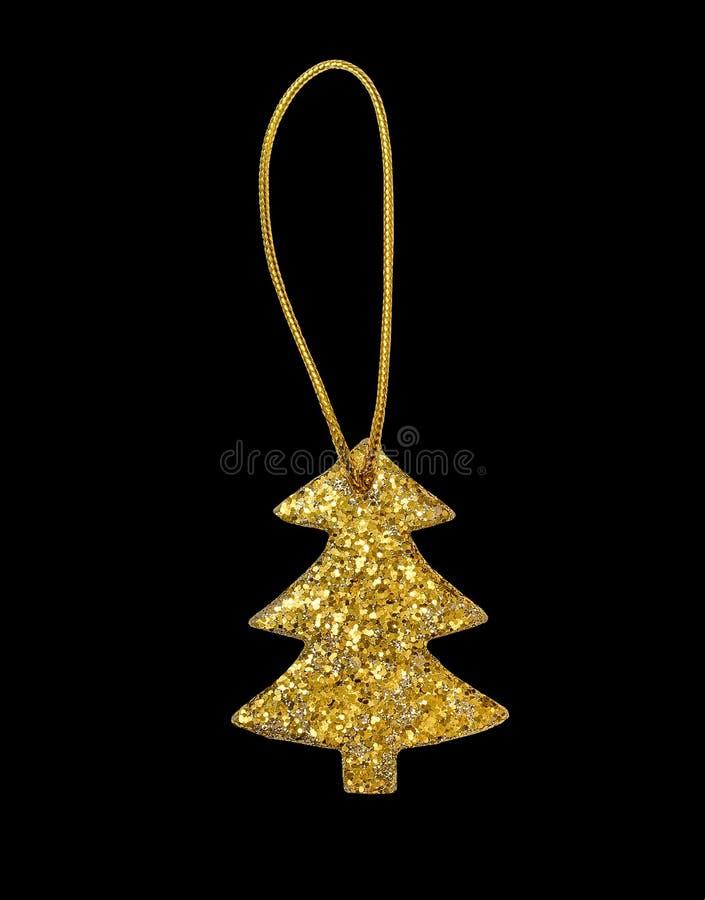 Décoration d'or d'arbre de sapin de Noël de scintillement d'isolement sur le noir images libres de droits